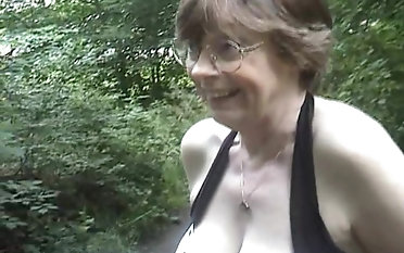 MILF close by some attachment exterior riding a heavy wiener ardently